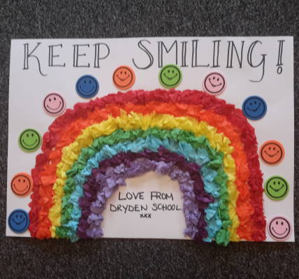 Keep Smiling by Dryden School, Low Fell, Gateshead - a picture of a rainbow surrounded by smiling faces.